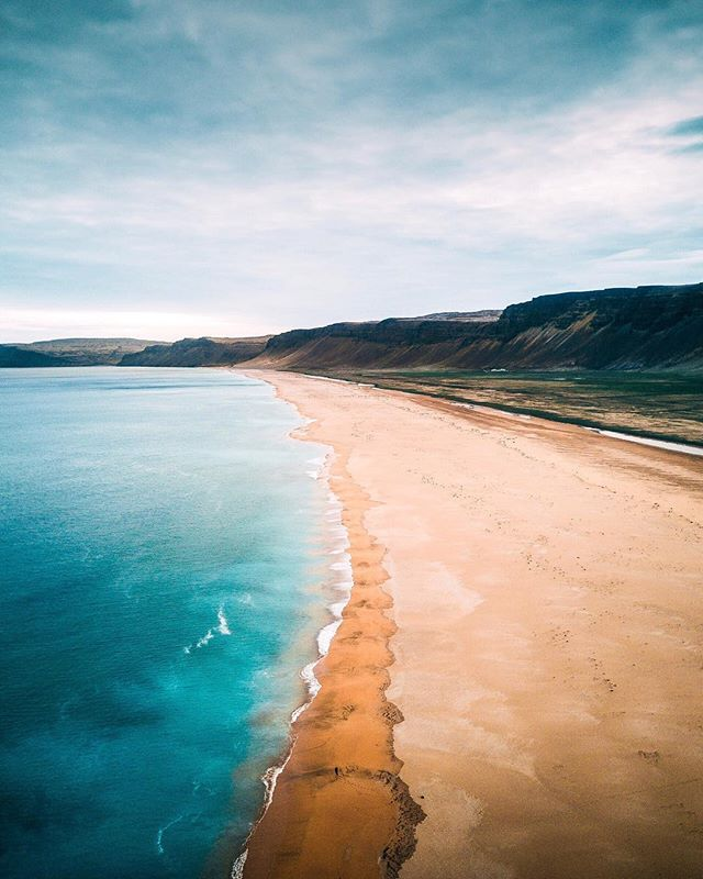 What's one place you've travelled to and will never forget? I remember this beach vividly. We drove well over 4 hours through mountain roads in the Westfjords of #iceland. Some of the roads weren't even paved! ⠀⠀⠀ Despite the long journey, we were excited every single second of the way! This is Rauðasandur beach or Red Sands beach. It's 10 KMof pristine coastline which is home to countless wildlife including seals and seabirds. Definitely one location I will never forget! @instagram #WHPawaywego