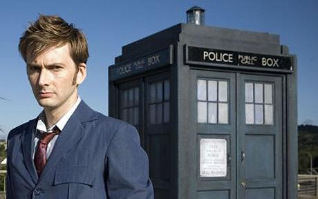 The Tenth Doctor (David Tennant) is pictured with his time machine, the TARDIS