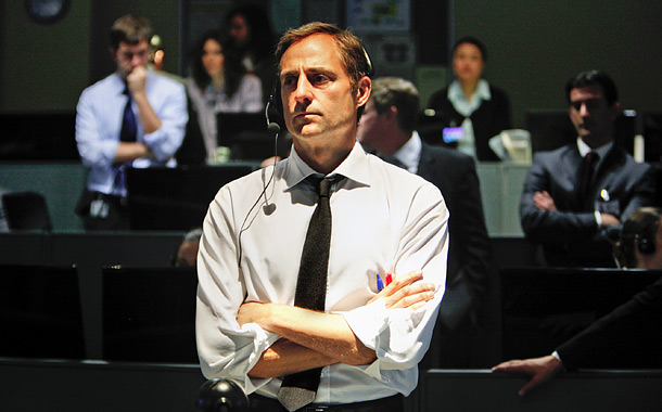Mark Strong as George, Maya's superior who helps convince the administration to listen to Maya