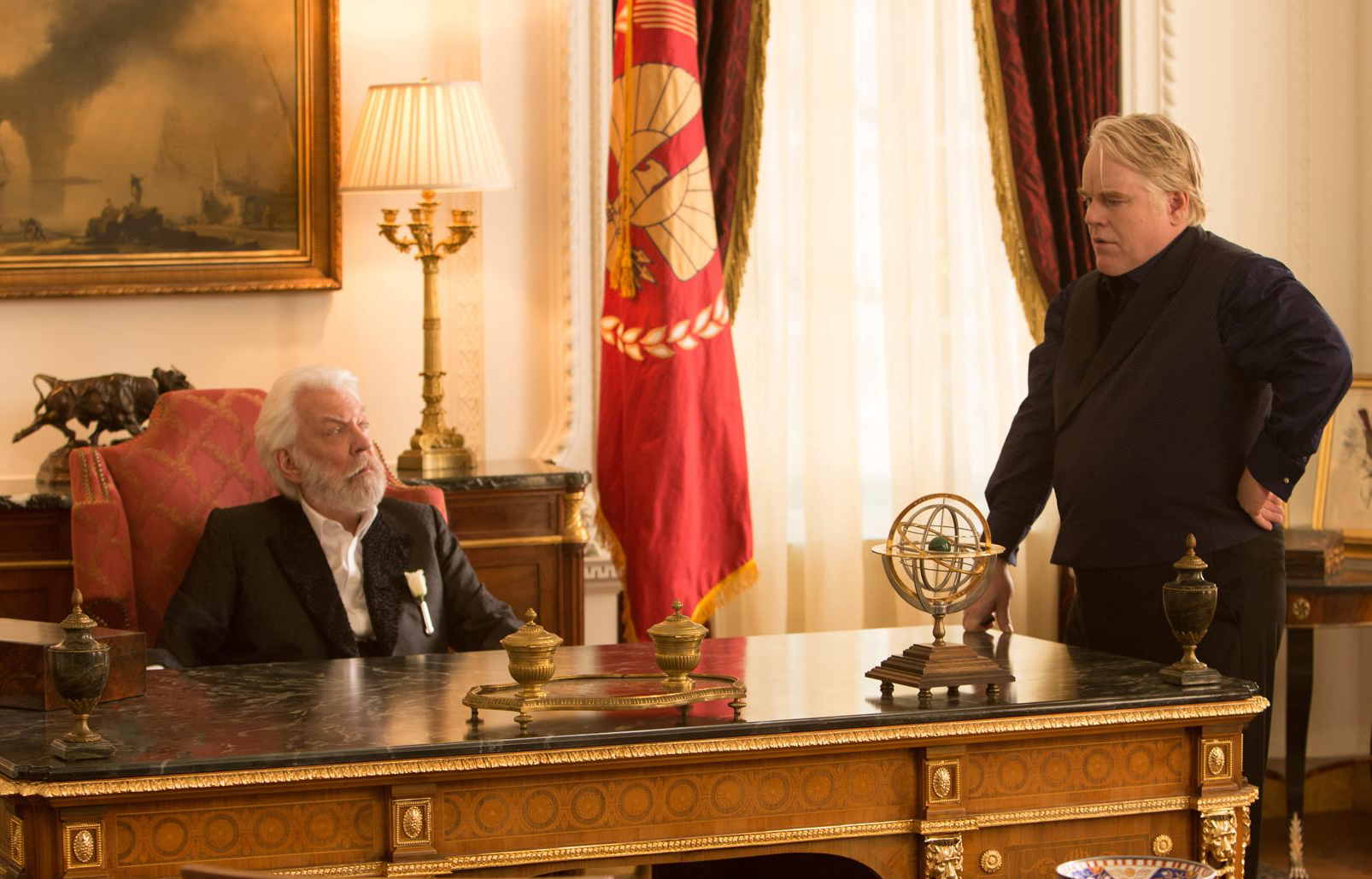 Donald Sutherland and Philip Seymour Hoffman as the villainous President Snow and Plutarch Heavensbee