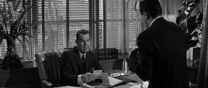 Fred MacMurray appears as Baxter's deceitful boss, Sheldrake