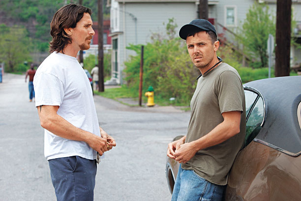 Bale and Affleck's brother characters are driven apart by bad luck and pride