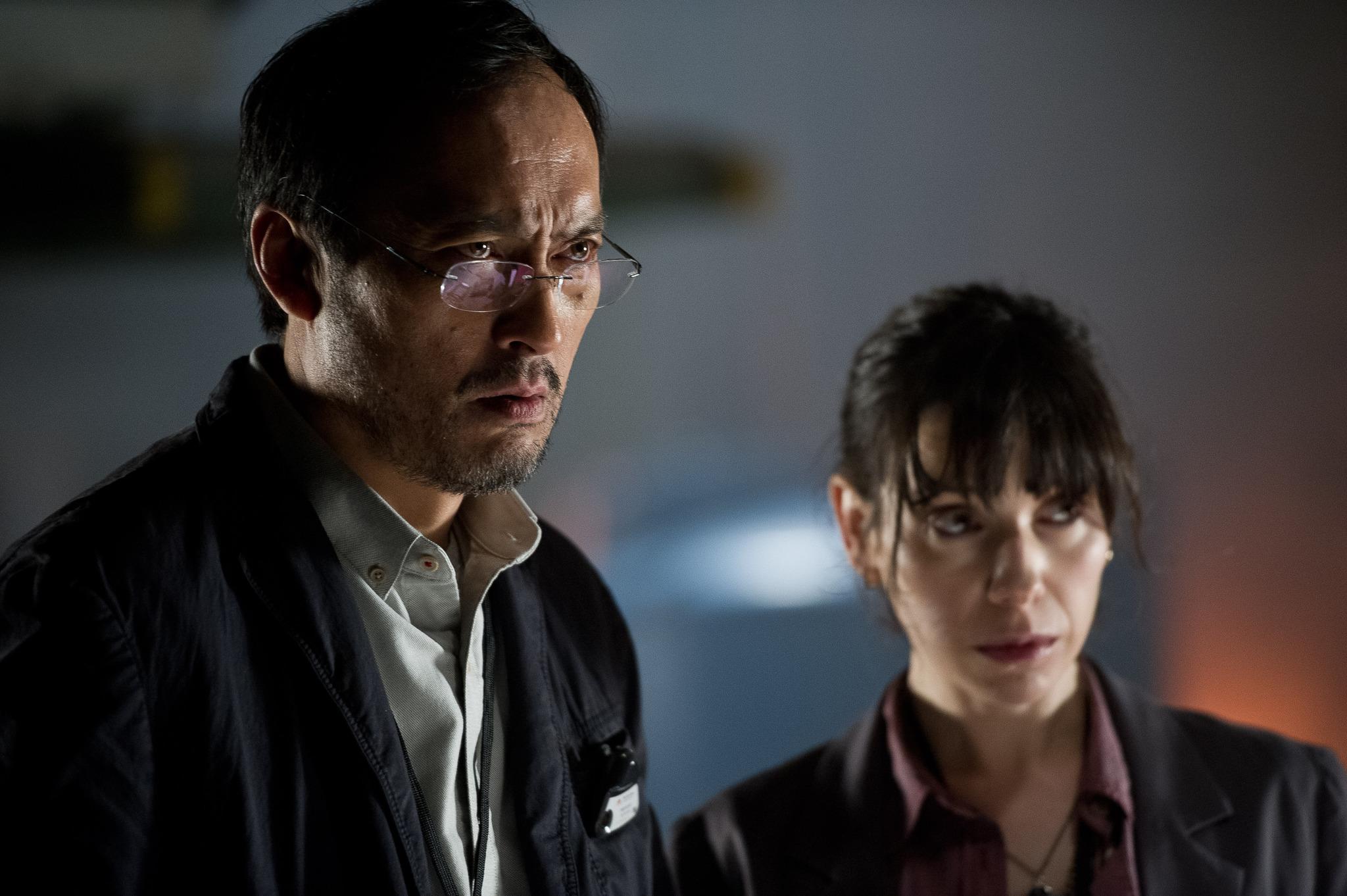 Ken Watanabe as Dr. Serizawa and Sally Hawkins as Vivienne Graham