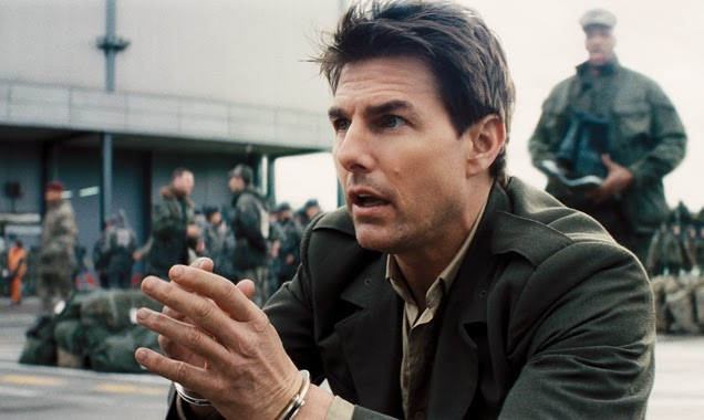 Tom Cruise as William Cage, a military PR officer turned unwilling recruit.
