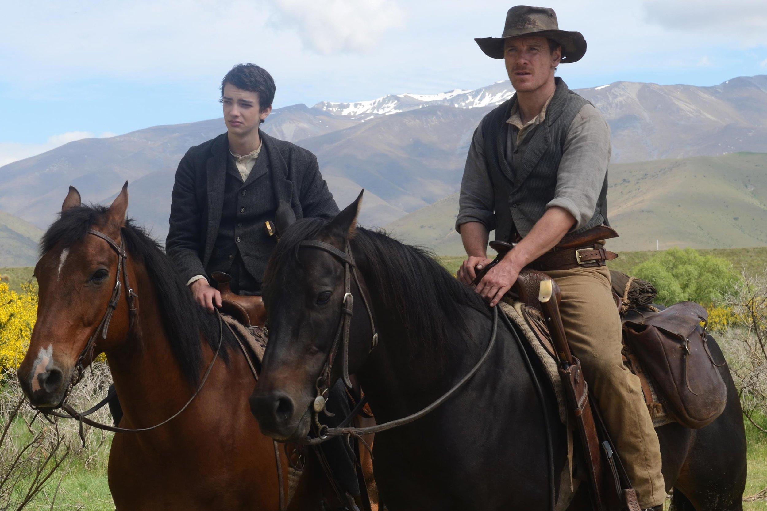 Kodi Smit-McPhee and Michael Fassbender in 'Slow West'