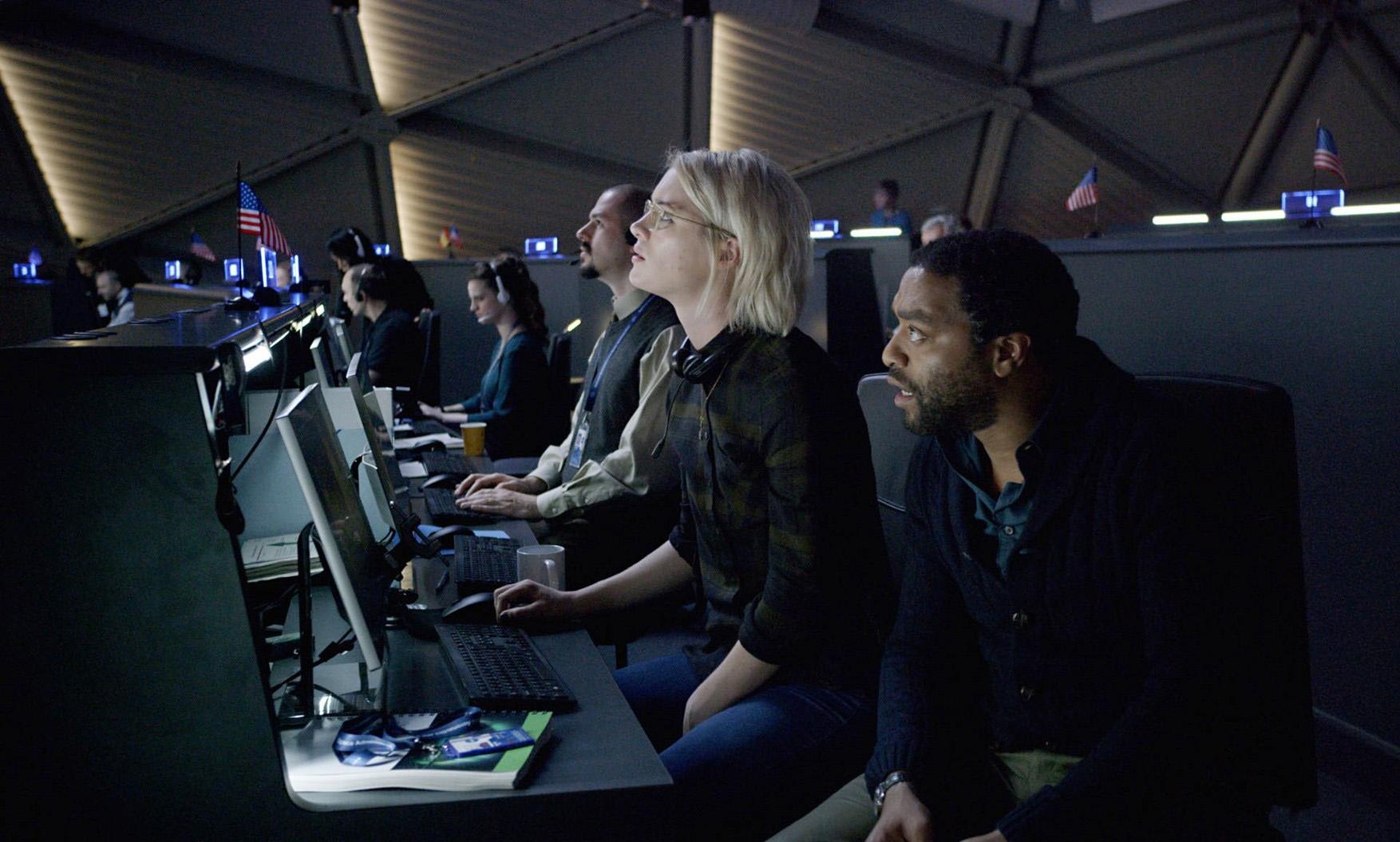 Mackenzie Davis (centre) and Chiwetel Ejiofor (right) play NASA scientists trying to get Watney home.