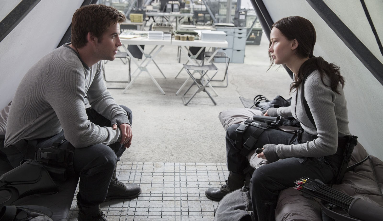 Gale (Hemsworth) and Katniss (Lawrence) plot their next move.