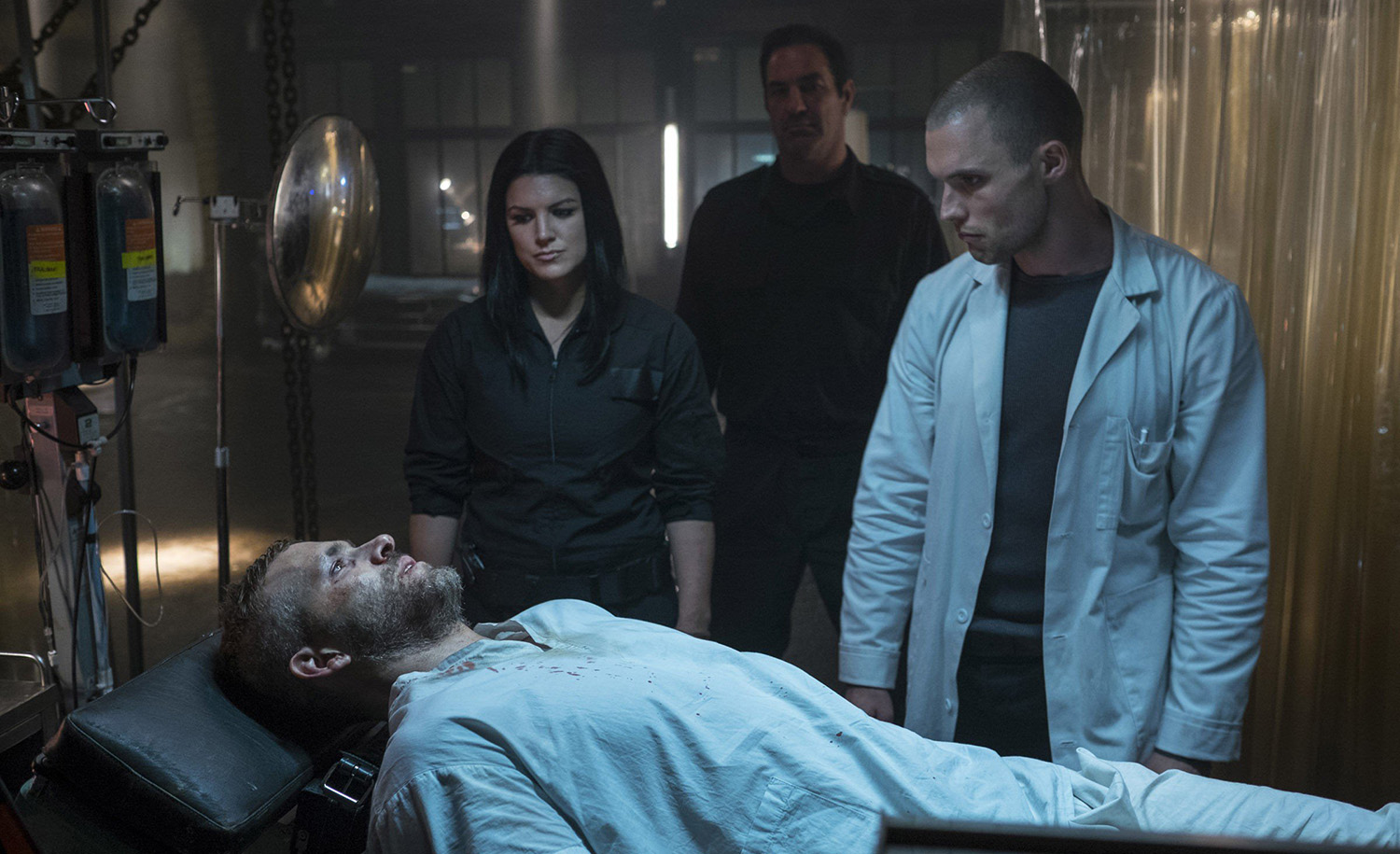 Francis (Ed Skrein) and Angel Dust (Gina Carano) prepare to trigger Wilson's mutation.