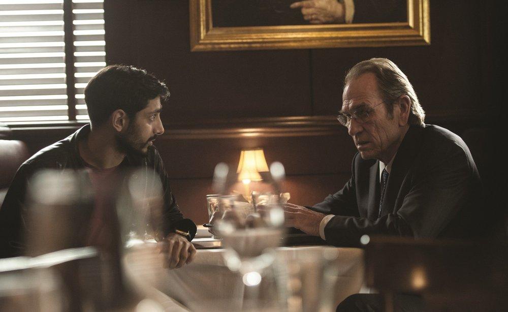 Riz Ahmed as Aaron Kalloor and Tommy Lee Jones as CIA Director Robert Dewey.