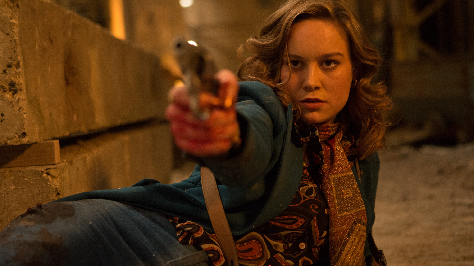 Brie Larson as Justine, who helps bring the arms dealers and buyers together.