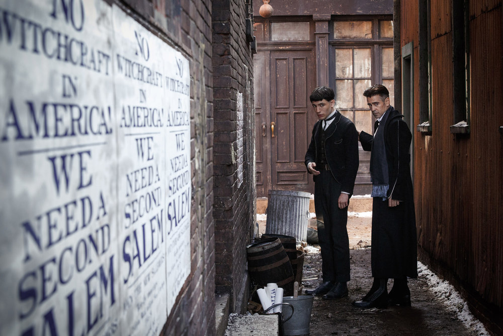 Ezra Miller as Credence Barebone and Colin Farrell as Graves.