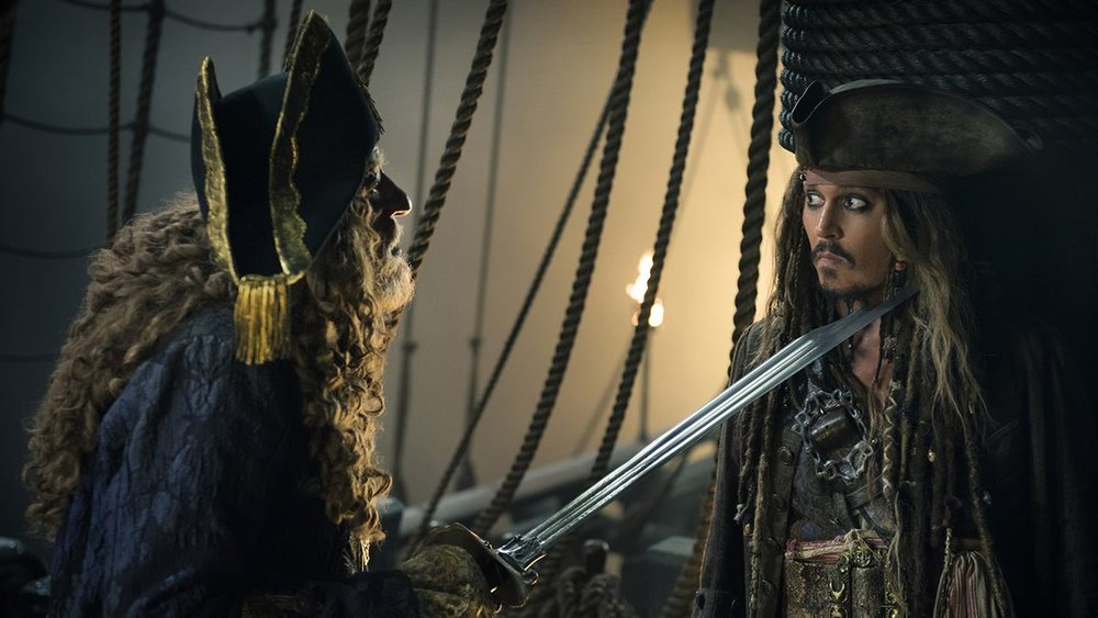 Geoffrey Rush and Johnny Depp in  Pirates of the Caribbean: Dead Men Tell No Tales , directed by Joachim Rønning and Espen Sandberg.