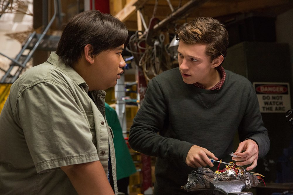 Jacob Batalon as Ned and Tom Holland as Peter Parker.