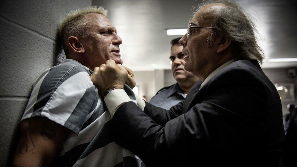 Daniel Craig as Joe Bang and Dwight Yoakam as Warden Burns.