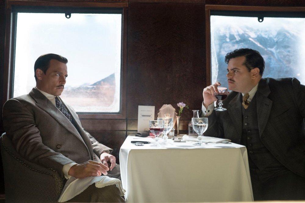 Johnny Depp as Samuel Rachett and Josh Gad as Hector MacQueen.