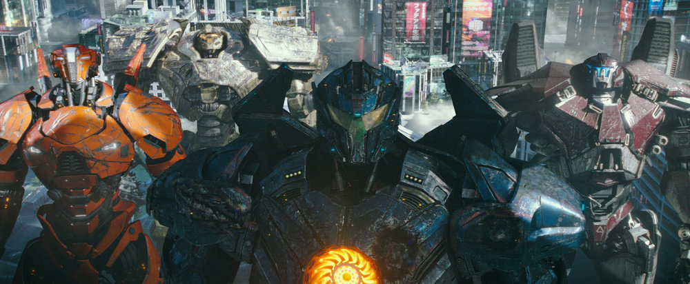A new force of giant Jaeger robots assembles to fight off the monstrous Kaiju in P acific Rim: Uprising , directed by Steven S. DeKnight.