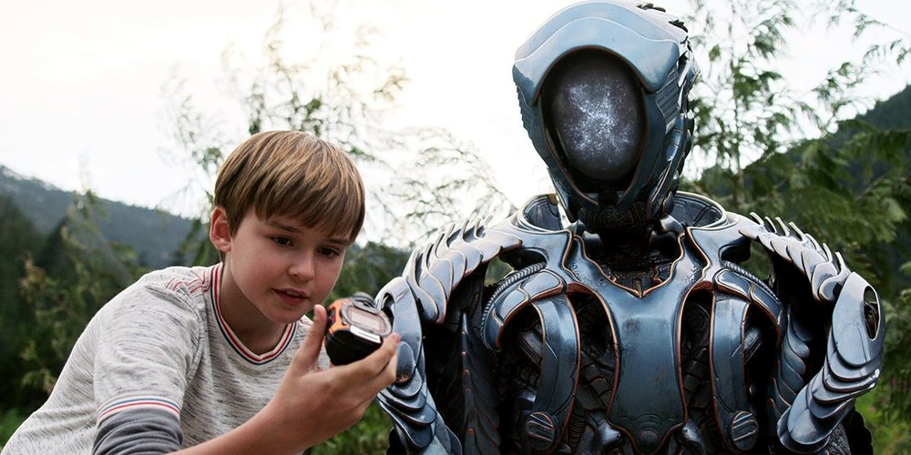 Maxwell Jenkins as Will Robinson and Brian Steele as the Robot in Netflix's  Lost in Space .