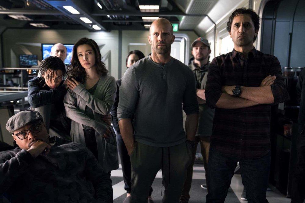 Jason Statham and Li Bingbing (centre) star in  The Meg , directed by Jon Turteltaub.