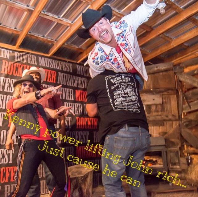 Kenny power lifting his buddy John Rich
