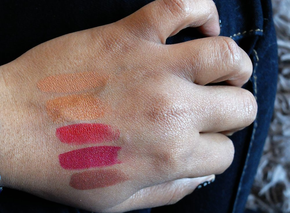 Luxury Moisture Lipsticks Top to Bottom: IMAN Nude, Sheer Gold, IMAN Red, Drama Queen and Hipster
