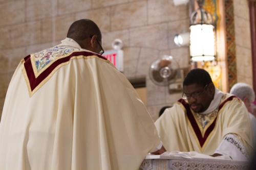 Fathers Cox and Kingsley preparing the Altar at the Re-dedication Mass of Holy Rosary.