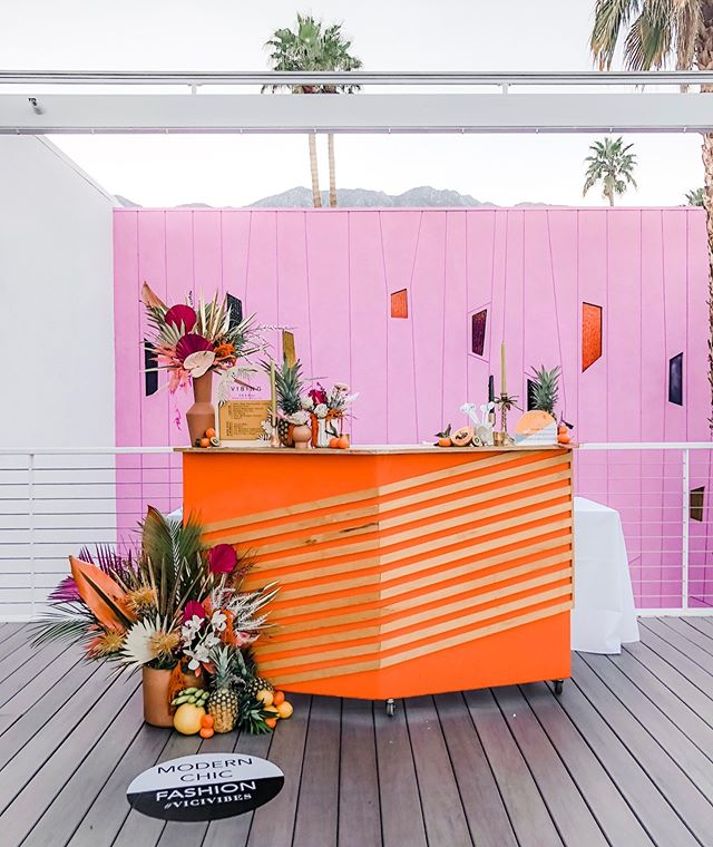 Color crushing hard over our bar install for @vicidolls at the @saguarohotels this weekend.  When the venue has killer rentals and pretty pink backdrops it makes my job easy.  Who else is ready for summer?! 🍊🍋🍍🧡💗 Concept for @vicidolls Desert Coachella  launch   Design + Styling @forrestandj   Floral Design @foxtail_florals   Custom Signage + Laser Goode @midnightconfetti