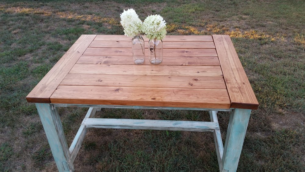 4' Farmhouse table with breadboard ends, straight legs with stained top