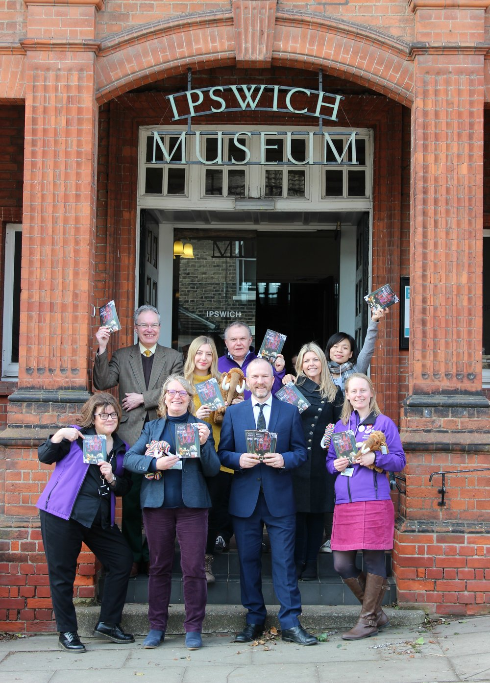 Staff celebrate the launch of the new museums brochure