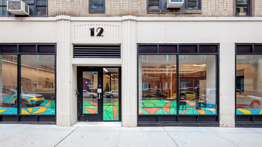 NYULeadership Lounge - The NYU Leadership Initiative storefront space provides an interactive dichroic film that increases visibility for the program and invites passersby to come in and be educated on student plans towards a better world.