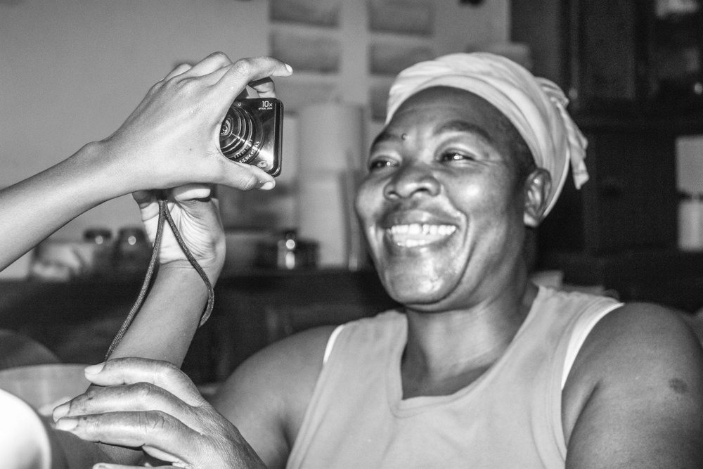 A woman looks at a picture of herself, taken by one of the local children. Many people in Haiti, as in most developing countries, rarely get to see themseleves in pictures.