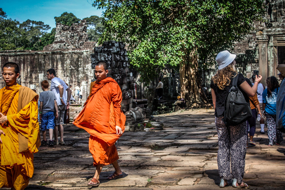 Young monks walk the sacred grounds of UNESCO World Heritage Site, Angkor Wat.