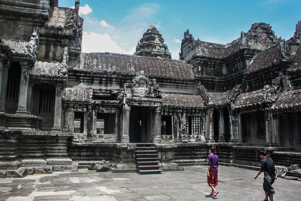 Tourists explore the temples of Angkor Wat.
