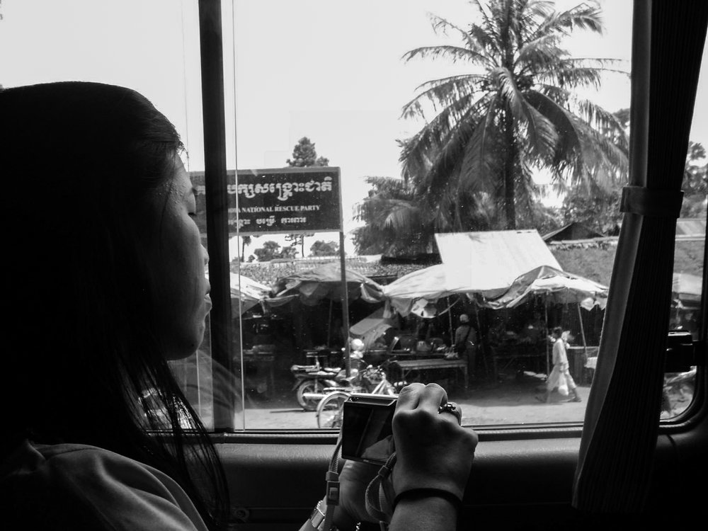 A volunteer gets her first glimpse of Cambodia as her uncle, a native of the country, gives a tour in his taxi.