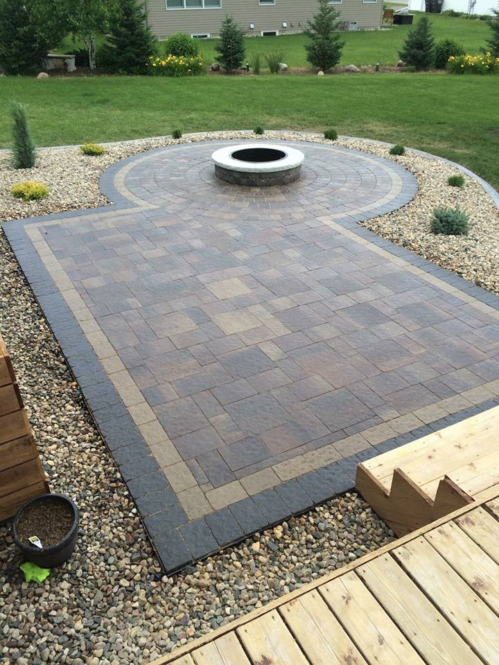 A very unique project here, integrating a circle patio with fire pit into a rectangular patio.