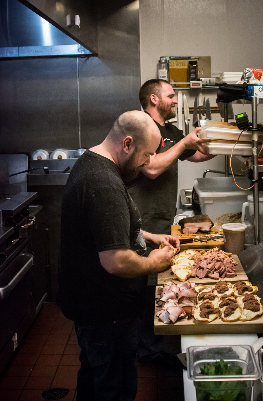 Chef Sam Boettler and Ian prepping the butcher's boards that greeted guests as they walked in (Planter's House Dinner)