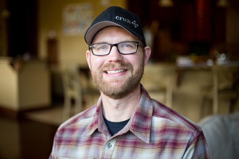 Josh Hayden, 40, at his home