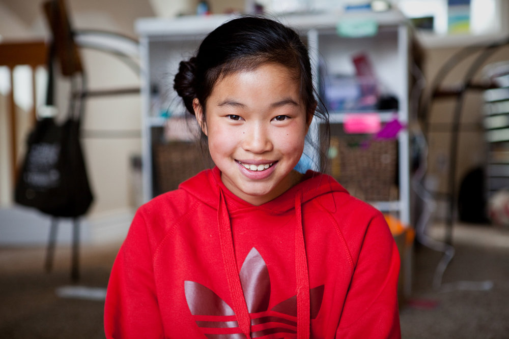 Arden Conde, 10, in front of her craft table at her home
