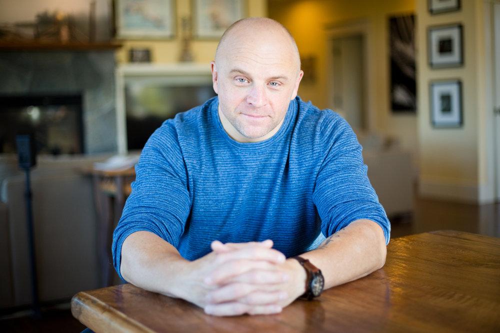 Charlie Thiel, 46, at his home