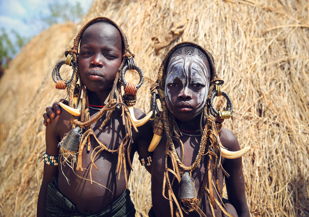 The Mursi (or Mun as they refer to themselves) are a  N ilotic pastoralist ethnic group in Ethiopia. They principally reside in the Southern Nations, Nationalities close to the border with South Sudan. According to the 2007 national census, there are 7,500 Mursi, 448 of whom live in urban areas.  Surrounded by mountains near the Omo River , the home of the Mursi is one of the most isolated regions of the country.