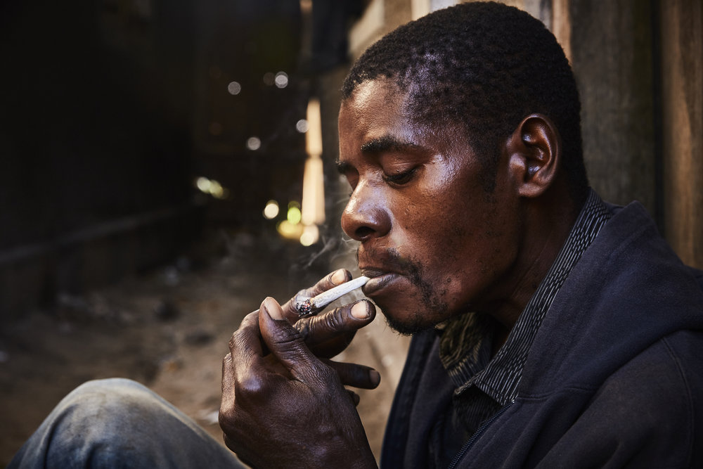 Haji Said is a 40 year old farmer, who started smoking heroin in 1985. He smokes in rolled paper/emptied cigarette casing inhaling the vapors it creates.