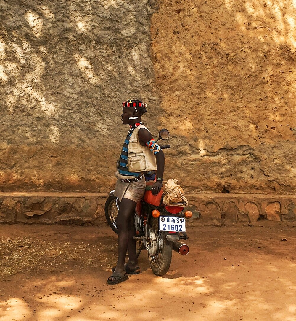 Bana tribesman with  motorcycle  Key Afer, Ethiopia