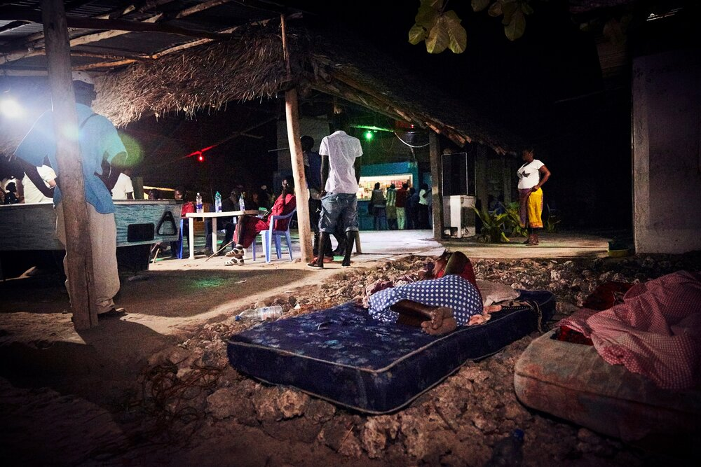 On a slow night, the women have dragged their sleeping mattresses outside, hoping to catch a breeze in Zanzibar's 90+ degree weather.
