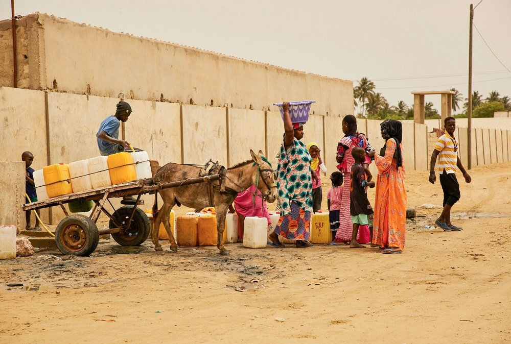 The arid area where the fishermen and their families have been relocated, is not connected to any water lines.   Here, residents collect water that is brought in via carted mule.