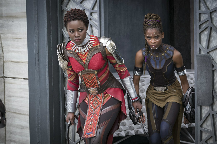 Lupita Nyong'o as Nakia and Letitia Wright as Shuri in Black Panther.jpg