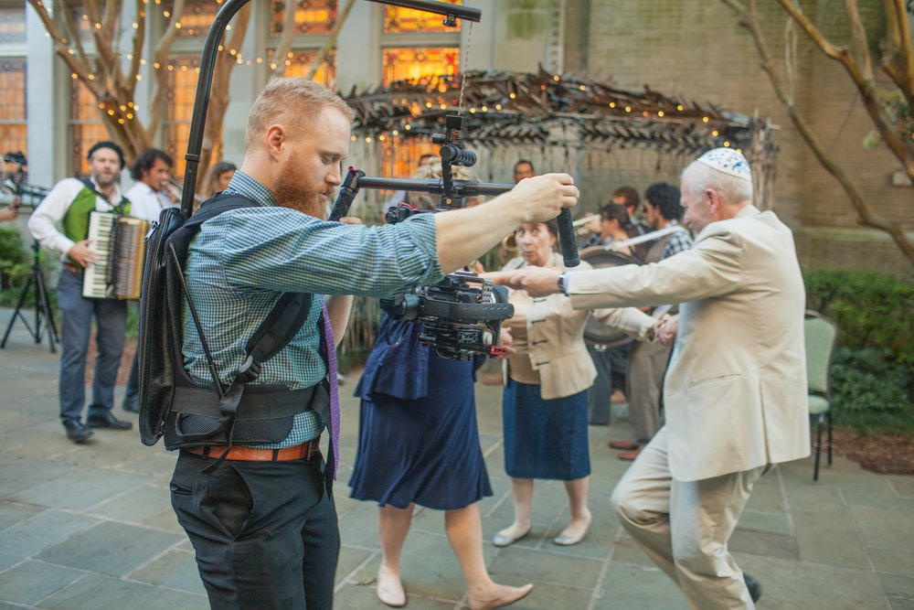 Ryan getting truly cinematic camera movements of wedding guests dancing at Touro Synagogue in New Orleans, Louisiana.