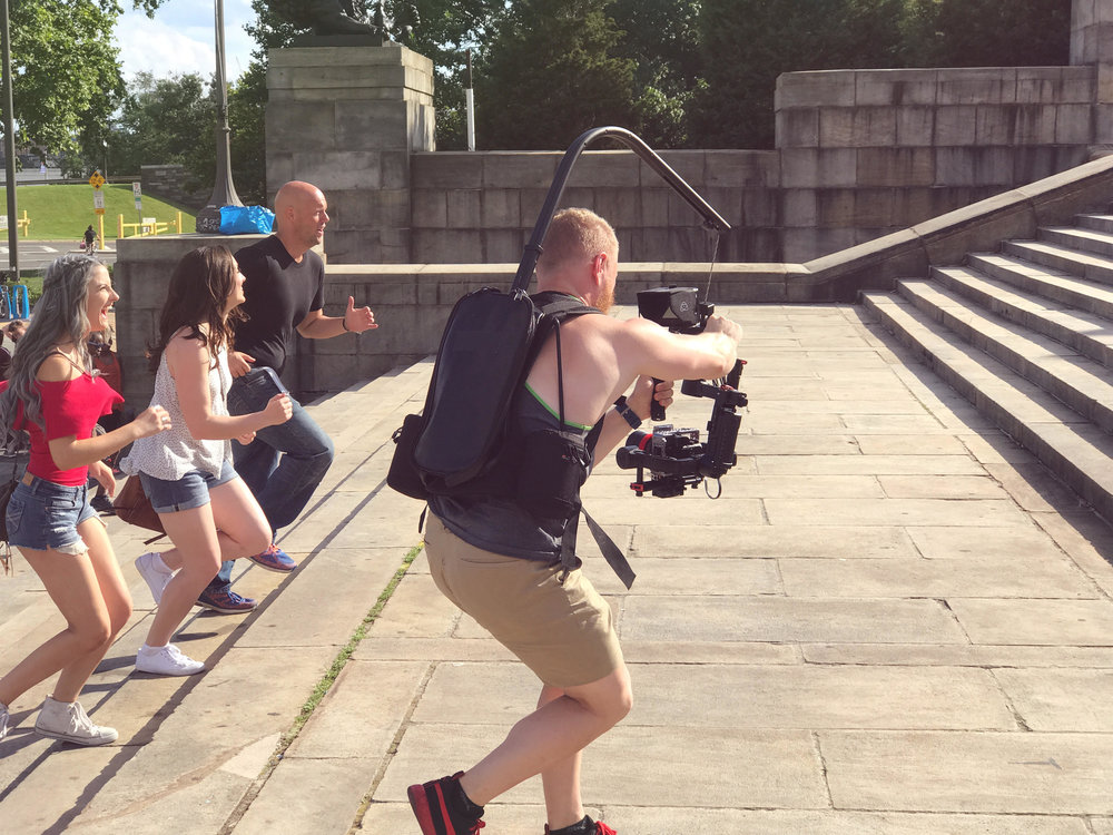 Ryan running and filming backwards at the iconic Rocky Steps at the Philadelphia Museum of Art, in Philadelphia, Pennsylvania.