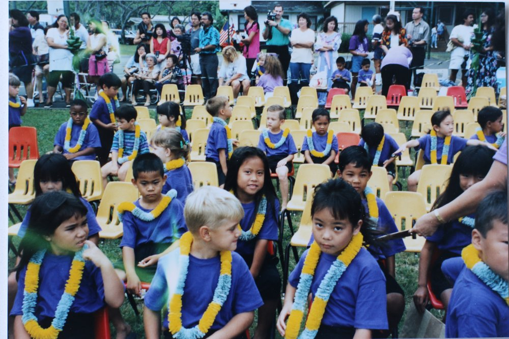 My restless kindergarten class before our May Day dance. Despite the 'tude being served in the front, I'm actually the one smiling in the center of the second row.