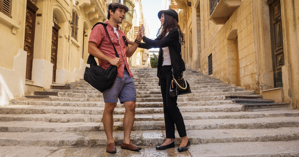 """PHOTO : Giovanni and Carmen get into a heated discussion in Malta's capital city of Valletta.  (L to R) Myko Olivier and Marysia S. Peres star in """" LOVE TO PARADISE """". Photo: Courtesy of Galea Pictures.© 2017 Galea Pictures. All Rights Reserved."""