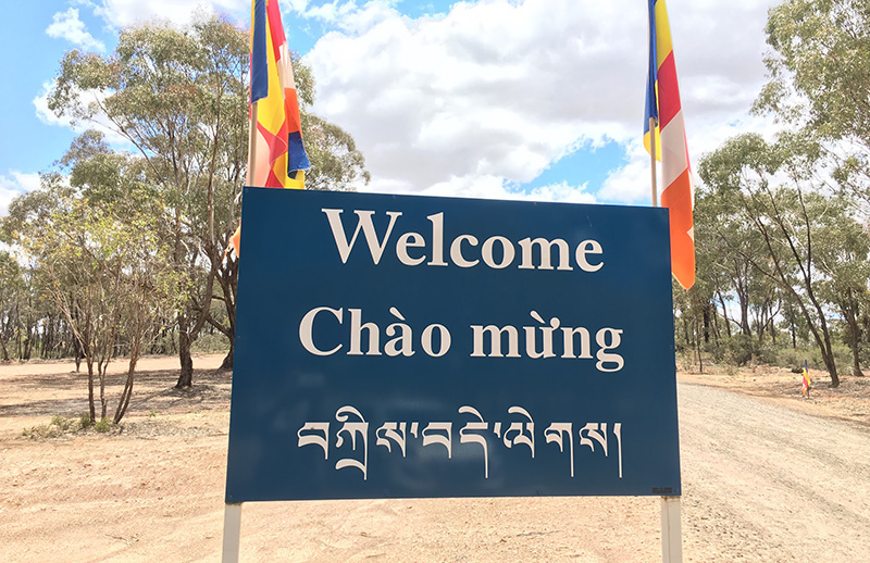 Photograph by Catherine Schieve. Multilingual welcome sign, Stupa of Universal Compassion, Bendigo.