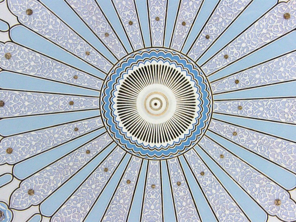 Symmetrical ceiling design - looking up at the dome inside the Islamic Museum, Kuala Lumpur.